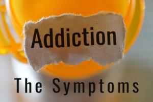 the symptoms of addiction